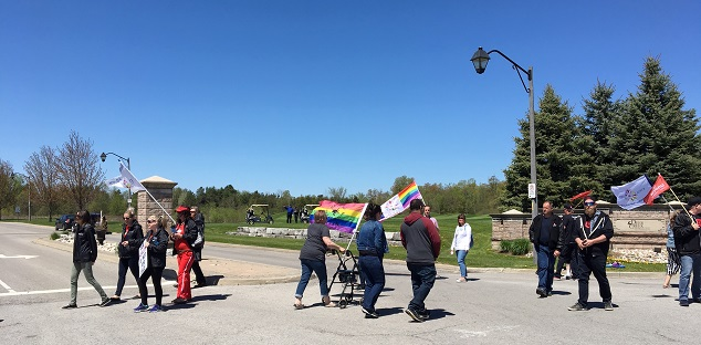 Protesters block entrance to Deer Creek Golf Course ahead of Ford event