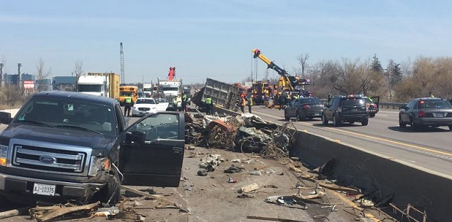 Truck driver facing charges after rollover on 401 in Milton | Durham