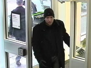 Durham police release pictures of man accused of scamming Whitby bank